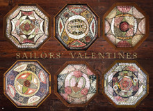 "Sailors' Valentines delighted women in the Victorian era whose sailor sweethearts, fathers and brothers spent months and years at sea, returning with these unique love tokens. Exquisite works of shell art, Sailors' Valentines originated in Barbados, a frequent port of call for New England whaling ships. The charming mosaics, recognized by their octagonal wooden frame, sometimes incorporated sentimental messages and illustrations, and were created using hundreds and even thousands of tiny shells.   Puzzle art shows Sailors' Valentines which are part of a permanent collection held at the New Bedford Whaling Museum, New Bedford, Massachusetts. Part of the Old Dartmouth Historical Society, the Museum collects, preserves and interprets the artifacts and documents of historic whaling activity and regional maritime activity.   Puzzle size is 26.625"" x 19.25"", 500 pieces."