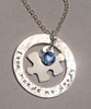 "Stamped ""Love Needs No Words"" Washer with floating Jigsaw Puzzle Piece and Blue Swarovski Crystal, all Sterling Silver Necklace with choice of chain. It is shown with a Hammered Finish. Choose from five custom finish options. Use the drop down menu if you would like to add Genuine Swarovski Birthstone.  *(Please note the finish choice is only for the outside washer only. Please leave notes in ""Special Instructions"" if you would like the Puzzle Piece to have a different finish as well, otherwise it will come will come with a Polished Finish.)   SIZE: Solid Sterling Silver 20 gauge 1 1/4"" Washer Solid Sterling Silver 24 gauge Jigsaw Puzzle Piece approx. 4/5"" x 1/2""  One Blue Genuine Swarovski Crystal (You may choose a different color if you wish)"