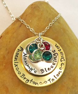 """Little Blessings Domed Mommy's, Grandma's or Aunt's Hand Stamped Solid Brass and Solid Sterling Silver Mixed Metal Necklace with Genuine Swarovski Birthstone Necklace and choice of chain. It is shown with a Polished Finish on a Solid Sterling Silver Cable Chain. One Birthstone is included. Use the drop down menu if you would like to add Genuine Swarovski Birthstones.  *Note-""""Little Blessings"""" is the default text that will be stamped on the brass disk  if no other text is requested."""