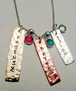 """Triple RectangleTag Mommy Necklace with Stamped Names in Sterling Silver, Copper & Brass Mixed Metal with Genuine Swarovski Crystal Birthstones and choice of chain. It is shown with a Hammered Finish on a Solid Sterling Silver Rolo Chain. Three tags, one in each metal are included and three Genuine Swarovski Birthstones are included. Use the drop down menues to add additional tags in metal of your choice. Use the drop down menu if you would like to add Genuine Swarovski Birthstones. *Sterling Silver spacers upon request only (Not available on large chains)   SIZE:  Tags vary in size depending on name length approx. 1/4"""" x 1-1 1/2"""" Solid Sterling Silver Rectangle Tag  Solid Copper Rectangle Tag  Solid Brass Rectangle Tag  Three Genuine Swarovski Crystal Birthstone choices *Sterling Silver spacers upon request only (Not available on large chains)"""