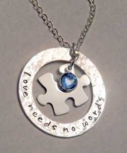 """Stamped """"Love Needs No Words"""" Washer with floating Jigsaw Puzzle Piece and Blue Swarovski Crystal, all Sterling Silver Necklace with choice of chain. It is shown with a Hammered Finish. Choose from five custom finish options. Use the drop down menu if you would like to add Genuine Swarovski Birthstone.  *(Please note the finish choice is only for the outside washer only. Please leave notes in """"Special Instructions"""" if you would like the Puzzle Piece to have a different finish as well, otherwise it will come will come with a Polished Finish.)   SIZE: Solid Sterling Silver 20 gauge 1 1/4"""" Washer Solid Sterling Silver 24 gauge Jigsaw Puzzle Piece approx. 4/5"""" x 1/2""""  One Blue Genuine Swarovski Crystal (You may choose a different color if you wish)"""