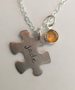 "Sterling Silver Stamped Jigsaw Puzzle Piece Autism Awareness with Genuine Swarovski Birthstone and choice of chain. It is shown with an Aged Finish on a Solid Sterling Silver Cable Chain. Choose from five custom finish options.The Swarovski Crystal can be blue for autism awareness if you like. Use the drop down menu to add Genuine Swarovski Birthstones.   SIZE: Solid Sterling Silver 24 gauge Jigsaw Puzzle Piece approx. 4/5"" x 1/2"" One Genuine Swarovski Crystal Birthstone choice"