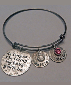 "Hand Stamped ""As long as I'm living, my baby you'll be"" Expandable Bangle Bracelet all Solid Sterling Silver. One size fits most. It is shown with an Oxidized Hammered Finish. Choose from five custom finish options. One name charm and Genuine Swarovski Birthstone included. Use the drop down menu if you would like to add Charms or Birthstones.  *(Please note the finish choice is only for the stamped charms only. Please leave notes in ""Special Instructions"" if you would like the bangle bracelet to have an aged look, otherwise it will come will come shiny silver.)   SIZE:  Expandable one size fits all 2 1/2""-3"" Solid Sterling Silver Bangle Bracelet 1.5mm. One Solid Sterling Silver 1"" Round stamped, ""As long as I'm living, my baby you'll be."" One Solid Sterling Silver 5/8"" Round Charm. One Swarovski Crystal Birthstone choice."