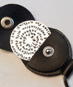 "Philippians 4:6 Stamped Entire Bible Verse Extra Large Token Coin Keychain with Optional Black Leather Case. Choice of Solid Sterling Silver, Solid Nickel, Solid Copper, or Solid Brass. It is shown in Solid Sterling Silver with a Polished Finish in a Black Leather Key Ring Case. Choose from five custom finish options. *AGED AND HAMMERED OXIDIZED ARE NOT AVAILABLE IN NICKEL.   Philippians 4:6 New King James Version (NKJV) Be anxious for nothing; but in everything by prayer and supplication with thanksgiving let your requests be made known unto God.  SIZE: Solid Sterling Silver 1 1/2"" Round"