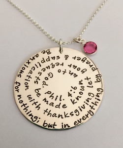 """Philippians 4:6 Bible Verse Necklace Extra Large Sterling Silver Round Hand Stamped with Swarovski Birthstone and choice of chain. It is shown with a Polished Finish on a Solid Sterling Silver Rolo Chain. Choose from five custom finish options. Use the drop down menu if you would like to add Genuine Swarovski Birthstones.    Philippians 4:6 New King James Version (NKJV) Be anxious for nothing; but in everything by prayer and supplication with thanksgiving let your requests be made known unto God.   SIZE: Solid Sterling Silver 1 1/2"""" Round  One Genuine Swarovski Birthstone choice"""