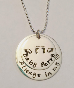 "Stamped Infant Loss Necklace ~ Sterling Silver Child Memorial Necklace ~ ""Always in my heart"" Baby Feet & Angel Wings Remembrance Necklace. It is shown with a Polished Finish on a Diamond Cut Bead Chain. Choose from five custom finish options. You can have a Date or Name below the baby feet if you like, or customize the text on the larger piece of silver. Use the drop down menu to add Genuine Swarovski Birthstones.  SIZE: Solid Sterling Silver 1"" Round with ""Always in my heart"" or custom text Solid Sterling Silver 3/4"" Round with baby feet and angel wings (optional name, date, other custom text)"