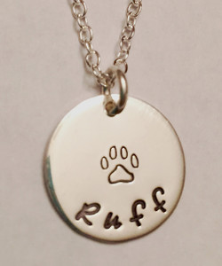 """Hand Stamped .925 Sterling Silver Dog Paw Print Necklace reading, """"Ruff."""" Dog Paw Animal Lover Necklace. Shown with a Polished Finish on a Solid Sterling Silver Cable Chain. Custom text can be stamped instead if you like. If you can think of it, I can stamp it. Choose from five custom finish options. Use the drop down menu to add Genuine Swarovski Birthstones.  SIZE:  Solid Sterling Silver 5/8"""" Round reading """"Ruff"""" with Paw Print"""