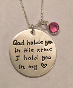 "Hand Stamped Round ""God holds you in His arms. I hold you in my heart."" Solid Sterling Silver Memorial Necklace with Swarovski Birthstone and choice of chain. Necklace is shown with a Brushed Finish on a Rolo Chain. Choose from five custom finish options. Use the drop down menu to add Genuine Swarovski Birthstones.   SIZE: One Solid Sterling Silver 1"" Round stamped, ""God holds you in His arms. I hold you in my heart."" One Genuine Swarovski Birthstone choice"