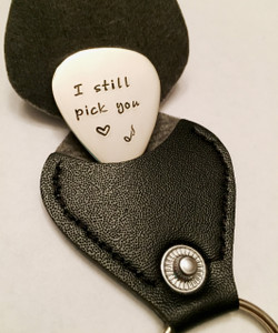 "DESCRIPTION: ""I Still Pick You"" Stamped Guitar Pick Key Chain with heart & music note with optional Black Leather Case. Shown with a Polished Finish in Solid Sterling Silver. Choose from five custom finish options. Choice of Solid Nickel, Solid Copper, Solid Brass, or Solid Sterling Silver. Double sided text optional.  *AGED AND OXIDIZED HAMMERED ARE NOT AVAILABLE IN NICKEL.   SIZE: 1 1/4"" x 1"" Guitar Pick"