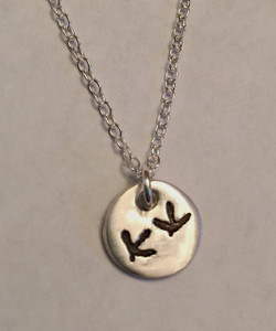 """Bird Tracks Necklace .999 Fine Silver (PMC). Size is Approx. 1/2"""". You have a choice of chain. Use the drop down menu to add Genuine Swarovski Birthstones. This listing is shown on a Solid Sterling Silver Cable Chain. This piece has an organic look and will not be perfectly round or flat. Each piece has subtle surface variations. *Note- Custom image can take the place of the bird tracks. I need an image that is not too busy on a white background.   Sterling Heart Songs Jewelry uses the highest quality PMC (Pure Metal Clay) with the strongest bonding metal available. .999 Fine Silver is almost Pure Silver and it starts out as a Metal Clay. We create a stamp of your exact image and stamp it into a Nice Thick Piece of Clay. The clay is then Kiln Fired, not hand fired like many other shops, for the strongest bond. It then turns into .999 Fine Silver Metal. It is Tumbled to make the metal even stronger and Hand Polished. Attention to detail is paid at every step while your piece is being created. The process of creating this piece is spanned out over multiple days. Production time for the Fine Silver Line of Jewelry takes around 3 weeks.  SIZE: Approx. 1/2"""" .999 Fine Silver."""