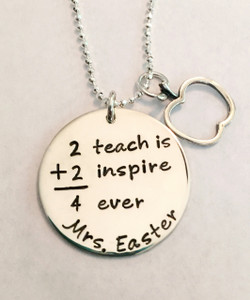 """Teacher Necklace """"2 Teach is 2 Inspire 4 Ever"""" Hand Stamped Math Saying, with optional Apple Outline Charm, all .925 Sterling Silver Necklace and choice of chain. It is shown with a Polished Finish on a Solid Sterling Silver Diamond Bead Chain. Choose from five custom finish options. Use the drop down menu to add Genuine Swarovski Birthstones.  SIZE: Solid Sterling Silver 1"""" Round  Solid Sterling Silver Apple Outline Charm Approx. .6""""x.7"""""""