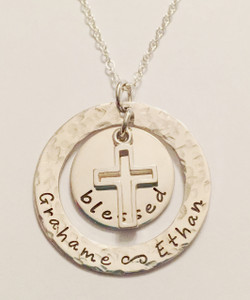 """blessed"" Mommy Necklace ~ Washer with Names, Round Charm, and Floating Cross Necklace, all Hand Stamped Solid Sterling Silver with choice of chain. It is shown with the word, ""blessed,"" however I can customize it to your needs. It is shown with a Hammered Finish on a Solid Sterling Silver Cable Chain. Choose from five custom finish options. Use the drop down menu to add Genuine Swarovski Birthstones.   SIZE:  1 1/4"" Solid Sterling Silver Washer hand stamped with ""your custom text"" 3/4"" Solid Sterling Silver Round Floating Charm stamped with ""blessed"" or your custom text Solid Sterling Silver Floating Open Cross"