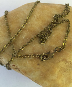 """3mm Aged Brass Cable Chain with Lobster Clasp. This Solid Brass Chain has a Brass base and an Antiqued Brass Finish. Available in 16"""", 18"""", 20"""", 24"""", 28"""", 32"""", or any custom length."""