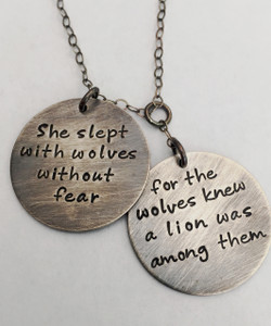 """She slept with wolves without fear, for the wolves knew a lion was among them"" ~r.m. drake poetry~  Hand Stamped Necklace with Two Round Staggered Charms in Solid Sterling Silver. It is shown with an Aged Finish on a Solid Sterling Silver Cable Chain that has been given an Aged finish as well. *Note- The chain will not come with an aged finish unless you choose one of the aged chains. Any sterling silver chain can be given an aged finish upon request; just leave notes when checking out that you would like your chain aged. Choose from five custom finish options. Use the drop down menu to add Genuine Swarovski Birthstones. This necklace is custom, personalized to your needs, and handmade with care.   SIZE: Two Solid Sterling Silver 1"" Round Charms"