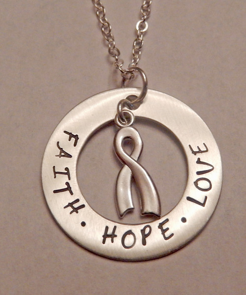"""Cancer Awareness FAITH, HOPE, LOVE one inch Washer with floating Cancer Awareness Ribbon all Sterling Silver Necklace with choice of chain.  It is shown with a with a Brushed Finish on a Solid Sterling Silver Cable Chain. Choose from five custom finish options. Use the drop down menu if you would like to add Genuine Swarovski Birthstones.    SIZE: Solid Sterling Silver 1"""" Washer Solid Sterling Silver Cancer Awareness Ribbon"""