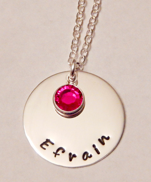 """7/8"""" Round Sterling Silver Charm with Stamped Name/s or Custom Text and Genuine Sworvski Birthstone with choice of chain. It is shown with a Polished Finish on a Solid Sterling Silver Cable Chain. Choose from five custom finish options. Use the drop down menu if you would like to add crystals.    SIZE:  Solid Sterling Silver 7/8"""" Round One Genuine Swarovski Crystal Birthstone choice"""