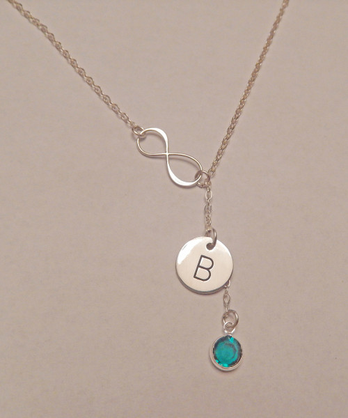 """Solid Sterling Silver Sideways Infinity Lariat Y shape Necklace with Hand Stamped Initial Charm and Genuine Swarovski Birthstone. It is shown with a Polished Finish on a Solid Sterling Silver Cable Chain. Choice of five custom finish options. This item is only available on select Cable Chains. Use drop down menu to add Solid Sterling Silver Charms. Use the drop down menu to add Genuine Swarovski Birthstones.    SIZE:  Solid Sterling Silver Infinity Link Solid Sterling Silver 1/2"""" Round One Genuine Swarovski Crystal Birthstone choice"""