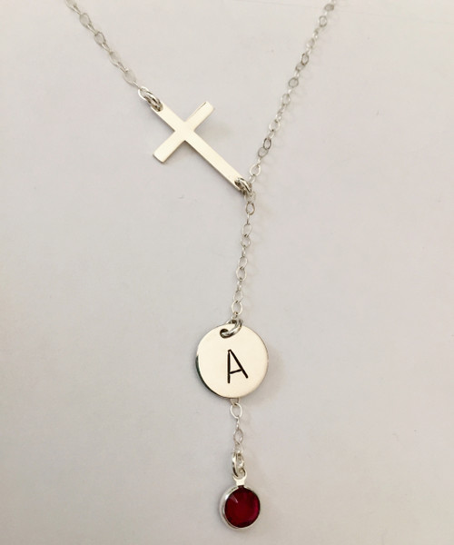 """Solid Sterling Silver Sideways Cross Lariat Y Shape Necklace with Hand Stamped Initial Charm and Genuine Swarovski Birthstone. It is shown with a Polished Finish on a Solid Sterling Silver Cable Chain. Choice of five custom finish options. This item is available only on select Cable Chains. Use the drop down menu if you would like to add Sterling Silver Charms. Use the drop down menu if you would like to add Genuine Swarovski Birthstones.   SIZE:  Solid Sterling Silver Cross Link One Solid Sterling Silver 1/2"""" Round One Genuine Swarovski Crystal Birthstone choice"""