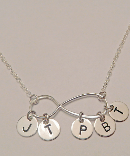 """My Forever Family Large Infinity Symbol with Hanging Hand Stamped Initial Charms, all Sterling Silver Necklace. It is shown with a Polished Finish on a Solid Sterling Silver Cable Chain. Choose from five custom finishes. This item is available only on select Cable Chains. To add Solid Sterling Silver 1/4"""" Round Initial Charm Initial Charms, use the drop down menu. Use the drop down menu if you would like to add crystal birthstones.    SIZE:  Solid Sterling Silver Infinity Symbol Approx. 1 1/5""""x2/5"""" Solid Sterling Silver 1/4"""" Round Initial Charm (Not included, but can be added using drop down menu)"""
