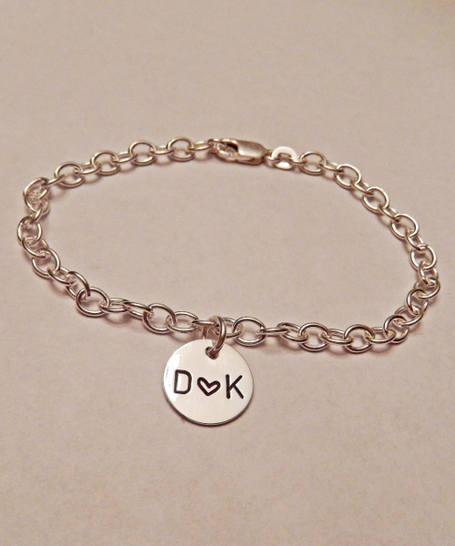 "Initial-Heart-Initial Charm Bracelet with 4mm links Initial Charm, all Solid Sterling Silver. It is shown with a Polished Finish. Choose from five custom finish options. Use the drop down menu if you would like to add more charms. Use the drop down menu if you would like to add Genuine Swarovski Birthstones.    SIZE:  Choose 7"", 8"", or 9"" Bracelet Length. 4mm width Solid Sterling Silver Charm Bracelet. One Solid Sterling Silver 1/2"" Round (Stamped with your choice of initials or custom text)   *To find your Bracelet size, measure your wrist and add 1/2"" to 1"". For Anklets, 9"" is average. -7"" fits most small-medium wrists. -8"" fits most large-Xlarge wrists. -9"" fist most XXlarge wrists and average size Ankles. *Please measure to be sure; I do not take responsibility for sizing issues."