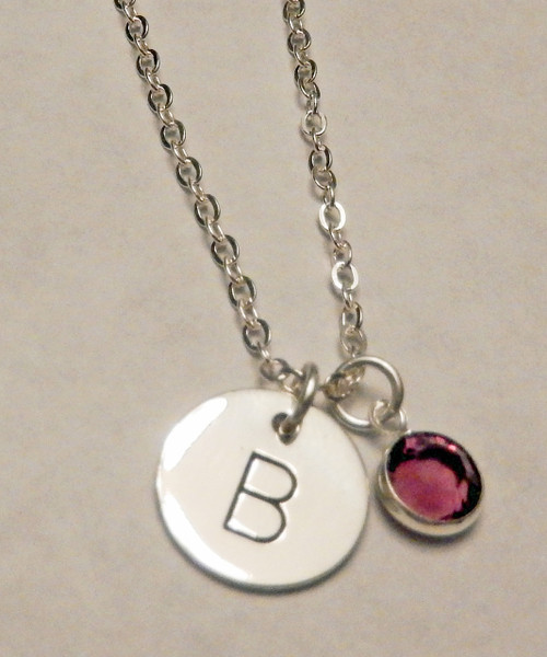 """Hand Stamped Solid Sterling Silver Charm with one Genuine Sworvski Crystal Birthstone and choice of chain. It is shown with a Polished Finish on a Solid Sterling Silver Cable Chain. Choose from five custom finish options. Use the drop down menu if you would like to add Genuine Swarovski Birtstones.    SIZE:  Solid Sterling Silver 1/2"""" Round One Swarovski Crystal Birthstone choice"""