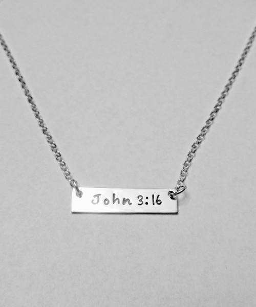 "Solid Sterling Silver Horizontal Rectangle Tag Necklace stamped with John 3:16 or your Custom Text. This necklace is shown with a Polished Finish on a Solid Sterling Silver Cable Chain. This item is available on select cable chains only. Choose from five custom finish options. Use the drop down menu if you would like to add Genuine Swarovski Birthstones.    John 3:16 King James Version (KJV) For God so loved the world, that he gave his only begotten Son, that whosoever believeth in him should not perish, but have everlasting life.   SIZE:  Solid Sterling Silver Rectangle Name Tag approx. 1"" x 1/4"""
