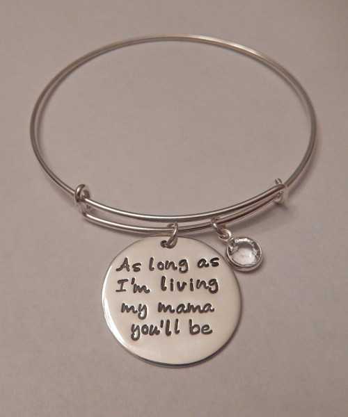 "Stamped ""As long as I'm living, my mama you'll be."" Charm on Expandable Bangle Bracelet, all Sterling Silver. One size fits most. It is shown with a Polished Finish on a Solid Sterling silver Bangle. Use the drop down menu if you would like to add Genuine Swarovski Crystal Birthstones. Use the drop down menu if you would like to add Solid Sterling Silver 5/8"" Name Charms as seen in other bangle listings. If adding multiple names and birthstones, let us know what name to pair up with what birthstone and the order you would like them hung.   SIZE:  Expandable one size fits all 2 1/2""-3"" Solid Sterling Silver Bangle Bracelet 1.5mm. One Solid Sterling Silver 1"" Round stamped, ""As long as I'm living, my mama you'll be."""