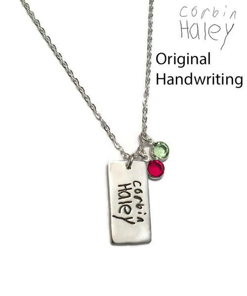 """Rectangle Actual Handwriting Necklace .999 Fine Silver (PMC). Use Handwriting from Mom, Dad, or a Loved One. Handwriting or a Drawing of a Child could be used. Handwriting of a Passed Loved One would make a Perfect Memorial Piece. Shown on a Solid Sterling Silver Cable Chain. Choose from large selection of chains. Use the drop down menu to add Genuine Swarovski Birthstones.   Sterling Heart Songs Jewelry uses the highest quality PMC (Pure Metal Clay) with the strongest bonding metal available. .999 Fine Silver is almost Pure Silver and it starts out as a Metal Clay. We create a stamp of your exact image and stamp it into a Nice Thick Piece of Clay. The clay is then Kiln Fired, not hand fired like many other shops, for the strongest bond. It then turns into .999 Fine Silver Metal. It is Tumbled to make the metal even stronger and Hand Polished. Attention to detail is paid at every step while your piece is being created. The process of creating this piece is spanned out over multiple days. Production time for the Fine Silver Line of Jewelry takes around 3 weeks.   SIZE: Approx. 1"""" x 1/2"""" .999 Fine Silver. Size will vary slightly based on the image submitted, but we adjust the image to best fit the desired size.   HOW TO ORDER: Please upload your image as you place your order. If you face technical issues or more than one image to upload, e-mail the image/s to info@sterlingheartsongs.com as an alternative. Make sure your scanned image is a clear picture taken straight on of the handwriting or drawing you will be using. The writing needs to be on plain white paper without patterns in the background. If it is on lined paper, it may be usable, please e-mail info@sterlingheartsongs.com first to be sure."""