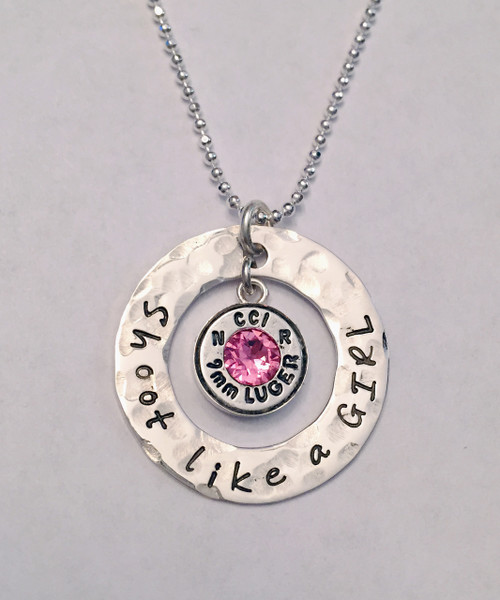 """Bullet Necklace Stamped """"Shoot like a GIRL"""" with Sterling Silver Washer, 9mm Luger Shell in Sterling Silver Bezel Cup & Genuine Swarovski Birthstone ~ Bullet Jewelry. It is shown with a Hammered Finish on a Diamond Cut Bead chain. Choose from five custom finish options. Optional upgrade to thicker Sterling Silver (from 20 gauge to 16 gauge) that can have text stamped on the back.   SIZE:  Solid Sterling Silver 20 gauge 1"""" Washer (Optional upgrade to 16 gauge) Real 9mm Luger Bullet Shell in Solid Sterling Silver Bezel Genuine Swarovski Birthstone (Choice of color)"""