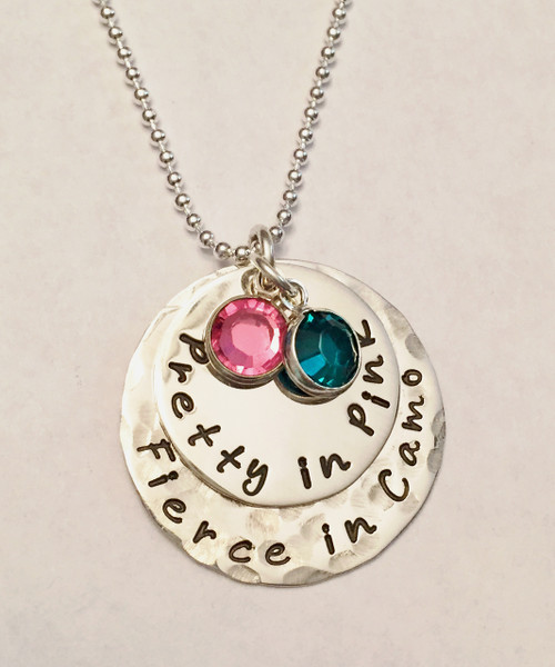 "Stamped, ""Pretty in Pink, Fierce in Camo"" Military Girl Armed Forces Necklace in Solid Sterling Silver & 2 Genuine Swarovski Crystals. Perfect for a Boot Camp Graduation Present or any gal who is serving or previously served in the Marines, Army, Navy, or Air Force. It is shown with the  Back Piece Hammered and Front Piece Polished on a Solid Sterling Silver Ball Chain. Choose from five custom finish options. Use the drop down menu if you would like to add Genuine Swarovski Crystals. *Please specify when checking out if you would like two finishes as shown because when you choose a finish, the entire necklace comes in that finish unless otherwise specified.   SIZE: Solid Sterling Silver 1"" Back Round with ""Fierce in Camo"" or custom text Solid Sterling Silver 3/4"" Front Round with ""Pretty in Pink"" or custom text 2 Genuine Swarovski Crystals, one pink and one green (or your choice of colors)"