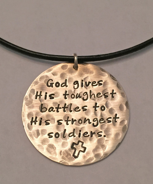 """Stamped Warrior Necklace, """"God gives His toughest battles to His strongest soldiers."""" Solid Sterling Silver Necklace. It is shown with an Oxidized Hammered Finish on a Black Leather Chain with Solid Sterling Silver Findings. Choose from five custom finish options. Custom Christian handmade jewelry designs for women and men.   SIZE:  Solid Sterling Silver 1 1/4"""" Round"""