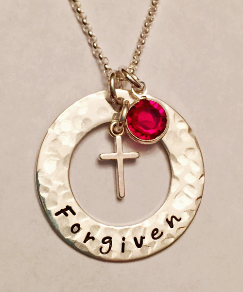 "Forgiven Necklace Washer with floating Cross and Genuine Swarovski Crystal, all Sterling Silver. You can modify the writing to say anything you like. If you can think it, we can stamp it. It is shown with a Hammered Finish on a Solid Sterling Silver Rolo Chain. Choose from five custom finish options. Use the drop down menu to add Genuine Swarovski Birthstones.  SIZE: 1"" Solid Sterling Silver Washer hand stamped, ""Forgiven"" Sterling Silver Cross One Genuine Swarovski Crystal"
