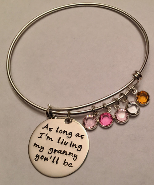 "Hand Stamped Round ""As long as I'm living, my granny you'll be"" on Expandable Bangle Bracelet all Sterling Silver. One size fits most. It is shown with a Polished Finish on a Solid Sterling Silver Bangle. Choose from five custom finish options. One Birthstone is included. Use the drop down menu to add 5/8"" Solid Sterling Silver name charms. Use the drop down menu if you would like to add Genuine Swarovski Crystal Birthstones.   SIZE:  Expandable one size fits all 2 1/2""-3"" Solid Sterling Silver Bangle Bracelet 1.5mm. One Solid Sterling Silver 1"" Round stamped, ""As long as I'm living, my granny you'll be."" or your custom text"