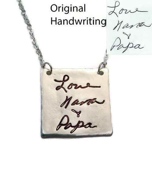 """Square Actual Handwriting Necklace .999 Fine Silver (PMC). Use Handwriting from Mom, Dad, or a Loved One. Handwriting or a Drawing of a Child could be used. Handwriting of a Passed Loved One would make a Perfect Memorial Piece. Shown on a Solid Sterling Silver Cable Chain. This item is only available on select cable chains.  Use the drop down menu to add Genuine Swarovski Birthstones. This piece has an organic look and will not be perfectly round or flat. Each piece has subtle surface variations.   Sterling Heart Songs Jewelry uses the highest quality PMC (Pure Metal Clay) with the strongest bonding metal available. .999 Fine Silver is almost Pure Silver and it starts out as a Metal Clay. We create a stamp of your exact image and stamp it into a Nice Thick Piece of Clay. The clay is then Kiln Fired, not hand fired like many other shops, for the strongest bond. It then turns into .999 Fine Silver Metal. It is Tumbled to make the metal even stronger and Hand Polished. Attention to detail is paid at every step while your piece is being created. The process of creating this piece is spanned out over multiple days. Production time for the Fine Silver Line of Jewelry takes around 3 weeks.  SIZE: Approx. 1 1/8"""" x 1 1/8"""" .999 Fine Silver. Size will vary slightly."""