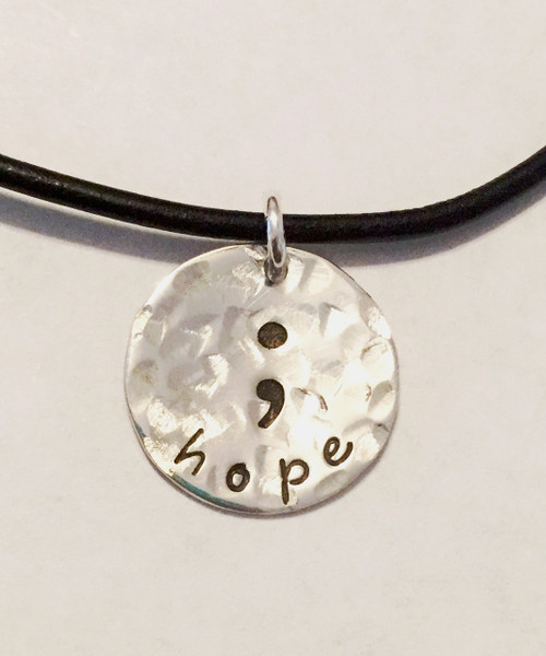 """Semicolon """"hope"""", all Sterling Silver, Round Hand Stamped Necklace and choice of chain. ~ Project Semicolon ~ Depression, Suicide, Addiction & Self-Injury Recovery & Prevention. Choose from five custom finish options. It is shown with a Hammered Finish on a Black Leather Chain with Solid Sterling Silver Findings. Use the drop down menu to add Genuine Swarovski Birthstones.   This piece is inspired by the Project Semicolon Movement. Project Semicolon (The Semicolon Project) is a faith-based non-profit movement dedicated to presenting hope and love to those who are struggling with depression, suicide, addiction and self-injury. """"A semicolon represents a sentence the author could have ended, but chose not to. The sentence is your life and the author is you."""" - Project Semicolon   SIZE:  Solid Sterling Silver 5/8"""" Round"""