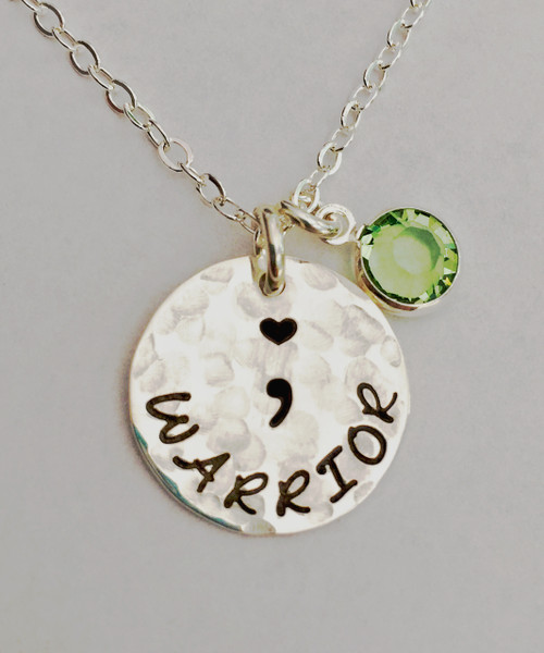"""Semicolon """"WARRIOR"""", all Sterling Silver, Round Hand Stamped Necklace and choice of chain. ~ Project Semicolon ~ Depression, Suicide, Addiction & Self-Injury Recovery & Prevention. Choose from five custom finish options. It is shown with a Hammered Finish on a Solid Sterling Silver Cable Chain. Use the drop down menu to add Genuine Swarovski Birthstones.   This piece is inspired by the Project Semicolon Movement. Project Semicolon (The Semicolon Project) is a faith-based non-profit movement dedicated to presenting hope and love to those who are struggling with depression, suicide, addiction and self-injury. """"A semicolon represents a sentence the author could have ended, but chose not to. The sentence is your life and the author is you."""" - Project Semicolon   SIZE:  Solid Sterling Silver 5/8"""" Round One Genuine Swarovski Birthstone choice"""