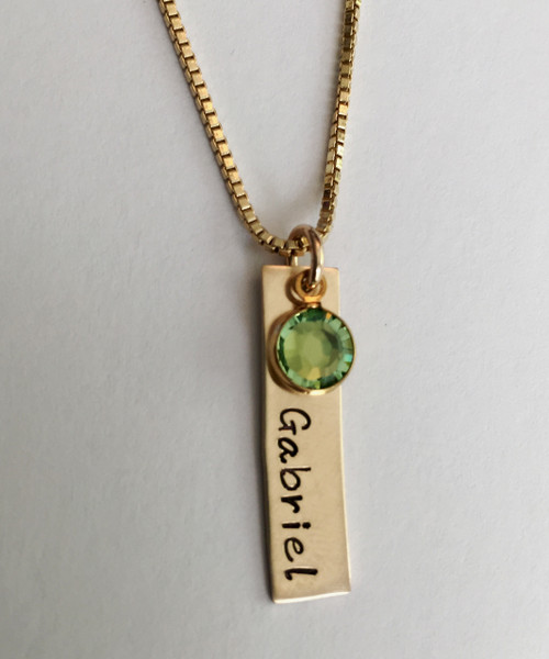 """14K Gold-Filled Rectangle Name Tag with Swarovski Crystal Birthstone Hand Stamped Personalized Custom Necklace. Necklace is shown Polished on a 14K Gold-Filled Box Chain. *Finish options are pictured in silver, but you will receive the product in 14K Gold Fill. Aged and Hammered Oxidized finishes not available in Gold-Filled.     SIZE: 14K Gold-Filled Rectangle Name Tag approx. 1"""" x 1/4"""" 14K Gold Plated Genuine Swarovski Crystal (Choice of Color)"""