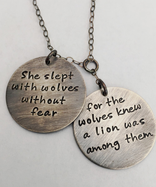 """""""She slept with wolves without fear, for the wolves knew a lion was among them"""" ~r.m. drake poetry~  Hand Stamped Necklace with Two Round Staggered Charms in Solid Sterling Silver. It is shown with an Aged Finish on a Solid Sterling Silver Cable Chain that has been given an Aged finish as well. *Note- The chain will not come with an aged finish unless you choose one of the aged chains. Any sterling silver chain can be given an aged finish upon request; just leave notes when checking out that you would like your chain aged. Choose from five custom finish options. Use the drop down menu to add Genuine Swarovski Birthstones. This necklace is custom, personalized to your needs, and handmade with care.   SIZE: Two Solid Sterling Silver 1"""" Round Charms"""