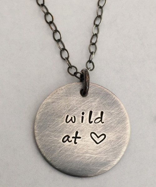 """wild at heart"" Hand Stamped Sterling Silver Round Necklace and choice of chain. Choose from five custom finish options. It is shown with an Aged Finish on a Solid Sterling Silver Cable Chain with an Aged Finish as well. *Note- The chain will not come with an aged finish unless you choose one of the aged chains. Any sterling silver chain can be given an aged finish upon request; just leave notes when checking out that you would like your chain aged. Choose from five custom finish options. Use the drop down menu to add Genuine Swarovski Birthstones. This necklace is custom, personalized to your needs, and handmade with care.   SIZE:  Solid Sterling Silver 5/8"" Round"