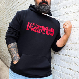 Adam Martin, CEO of the F5 Project, in the black F5 Project Community Not Incarceration Hoodie