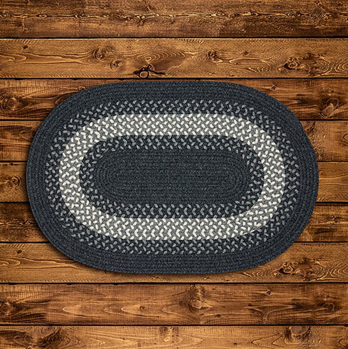 GRAY AREA BRAIDED RUG THIS FAMILIAR TWO-TONED DESIGN OF THIS WOOL-BLEND AREA RUG BRINGS A COZY SIMPLICITY TO ANY ROOM IN YOUR HOME.