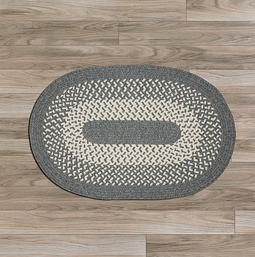 BRAIDED RUG TOUCH OF GRAY.  THIS FAMILIAR TWO-TONED DESIGN OF THIS WOOL-BLEND AREA RUG BRINGS A COZY SIMPLICITY TO ANY ROOM IN YOUR HOME. FREE PICK-UP.
