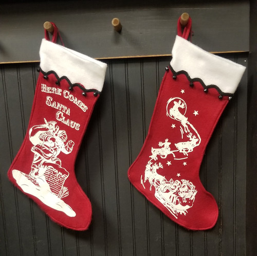 HERE COMES SANTA, AND SANTA WITH SLEIGH STOCKINGS. 17.75 X 10.5 INCHES MACHINE WASH COLD, LINE DRY ONLY.
