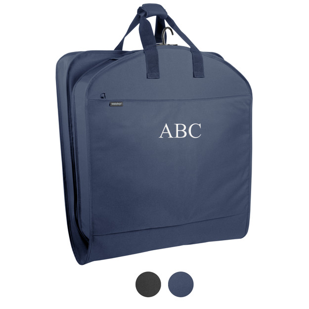 Navy blue garment bag folded in half to carry by handles. Garment bag with monogram, ABC, in white thread. Color dots showing  the different color variations of black and navy.