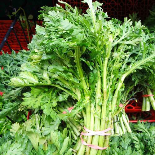 Edible Chrysanthemum leaves at market - (Chrysanthemum coronarium)