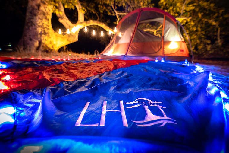 Lightweight lighted beach blanket with LED lights. Great for camping, hiking, the beach, festivals, keep you and your  stuff safe by lighting your space