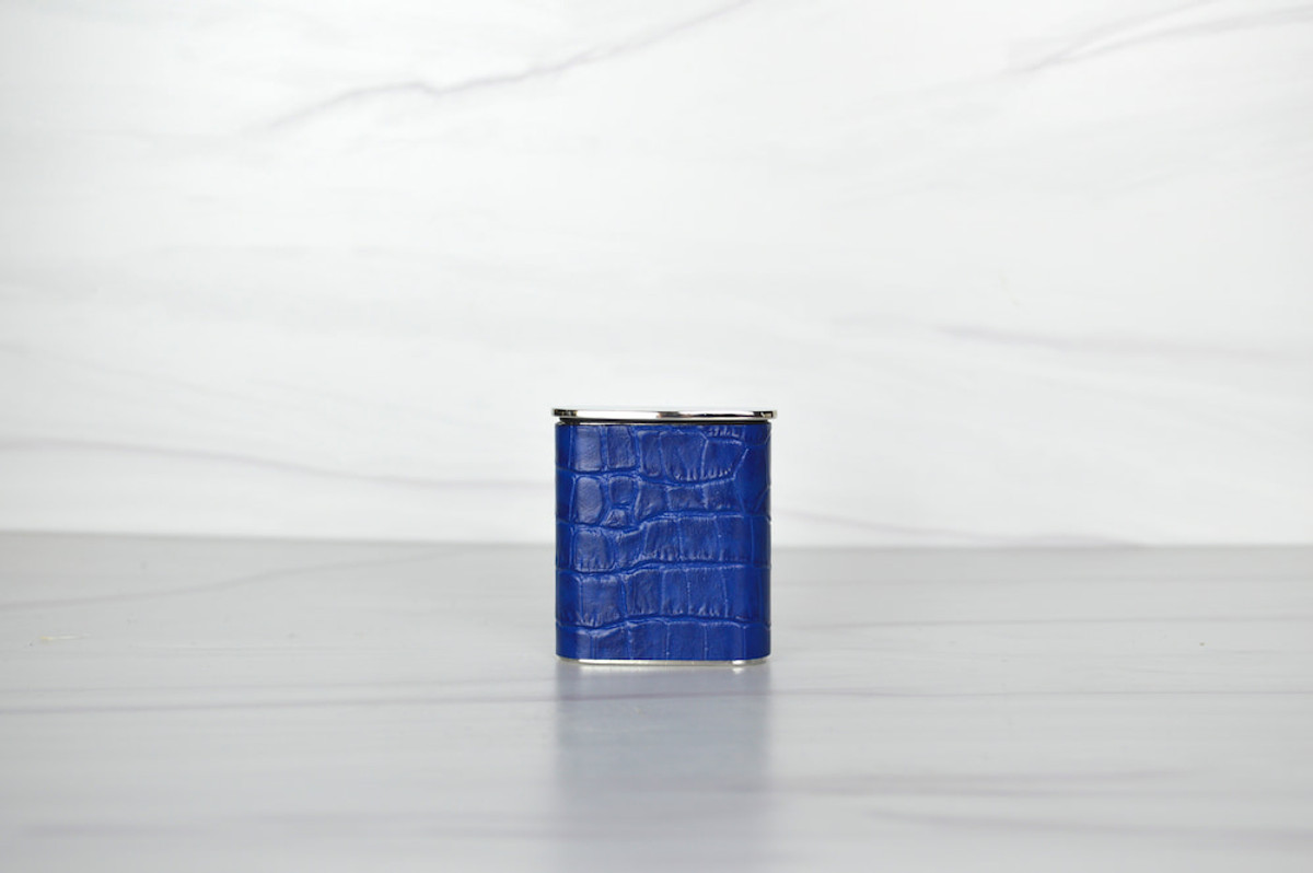 In blue, croc-embossed leather, our Poche Pocket  Ashtray is the new must-have in chic smoking accessories.