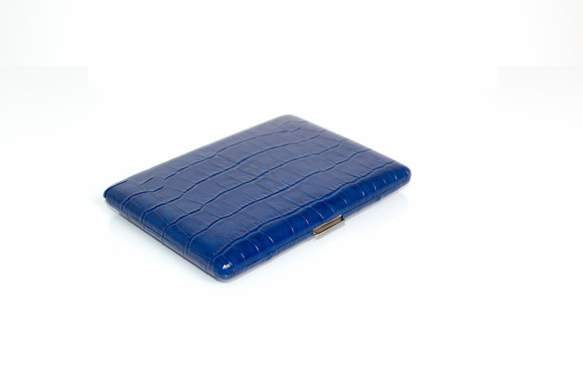 In croc-embossed Delaunay Lapis blue leather, our Malette Cigarette Case is the ultimate in chic smoking accessories.