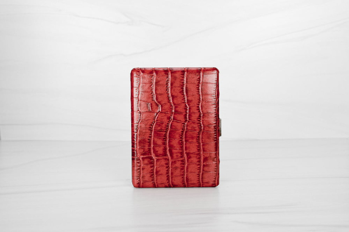 In croc-embossed red leather, our Malette Cigarette Case is the ultimate in chic smoking accessories.