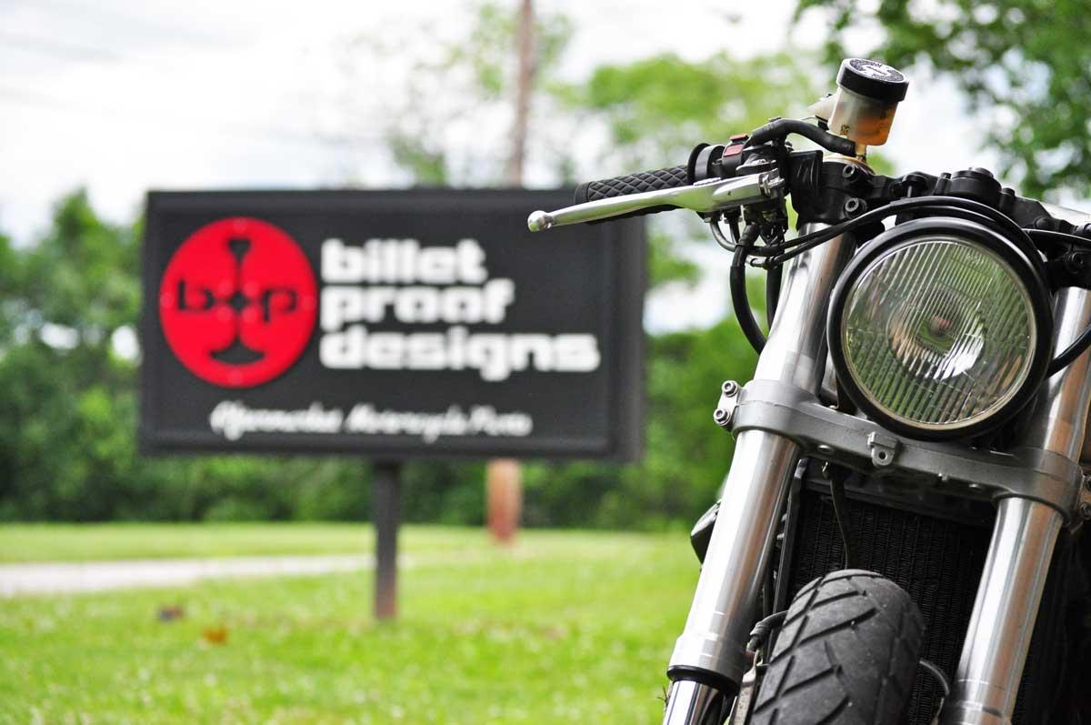 billet-proof-storefront-sign-with-bike-1.jpg